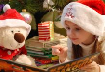 Child Reading with Christmas bear